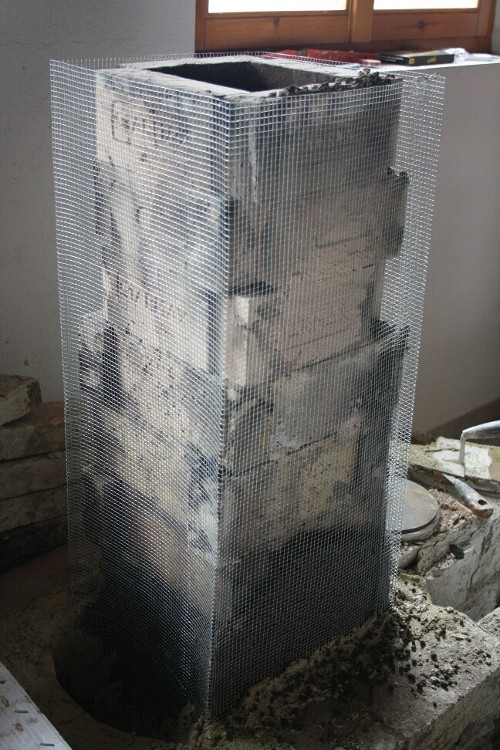 metallic wire mesh around the heat riser